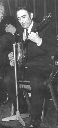Ray playing at a football club social - early 1980s.